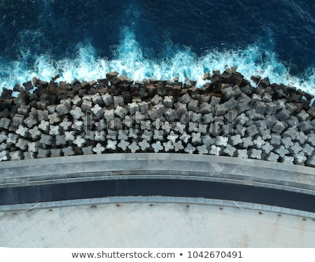 concrete-breakwaters-seascape-tetrapodes-protect-450w-1042670491.jpg