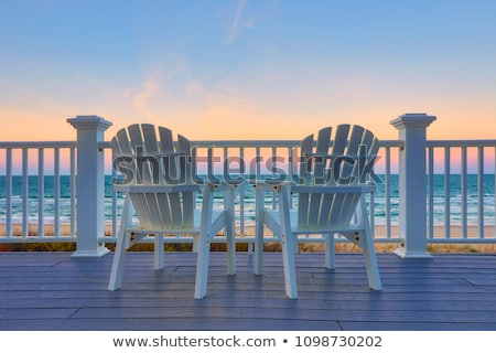 empty-adirondack-chair-on-deck-450w-1098730202.jpg